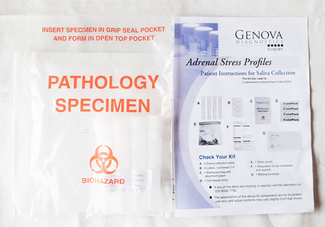 Photograph shows a specimen pathology bag and the instructions for the adrenal stress profile test kit.