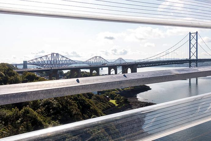 Photograph shows the view from the Queensferry Crossing of the Forth Road & Rail bridges