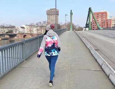 Walking across a bridge in Frankfurt following ACT treatment at Infusio
