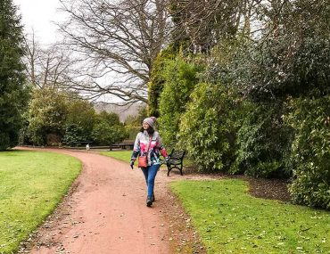 Photo shows Donna walking along a path at a park,