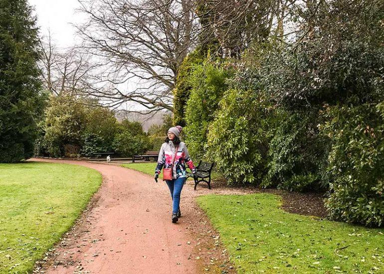 Photo shows Donna walking along a path at a park,