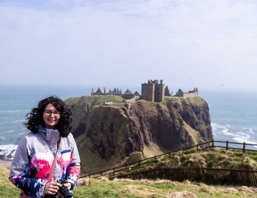 A photograph of me stood with Dunnottar Castle in the background.
