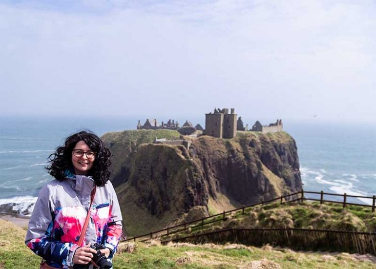 A photograph of me with Dunnottar Castle in the background. Find out how I am doing at six months post stem cells for Lyme Disease, Fibromyalgia and CFS.